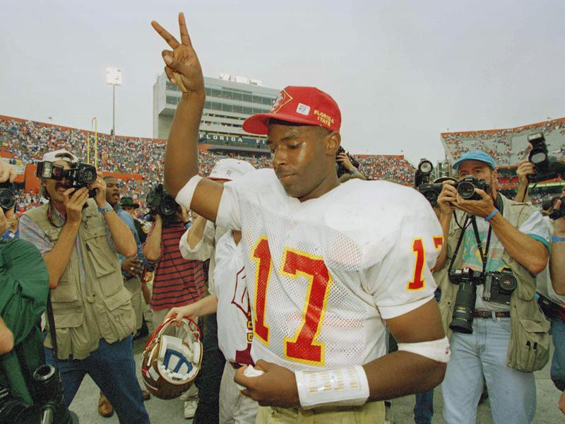Florida State quarterback Charlie Ward flashes victory sign