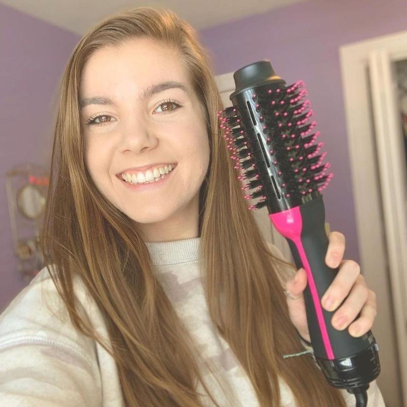 Woman holding up Revlon Salon One-Step Hair Dryer