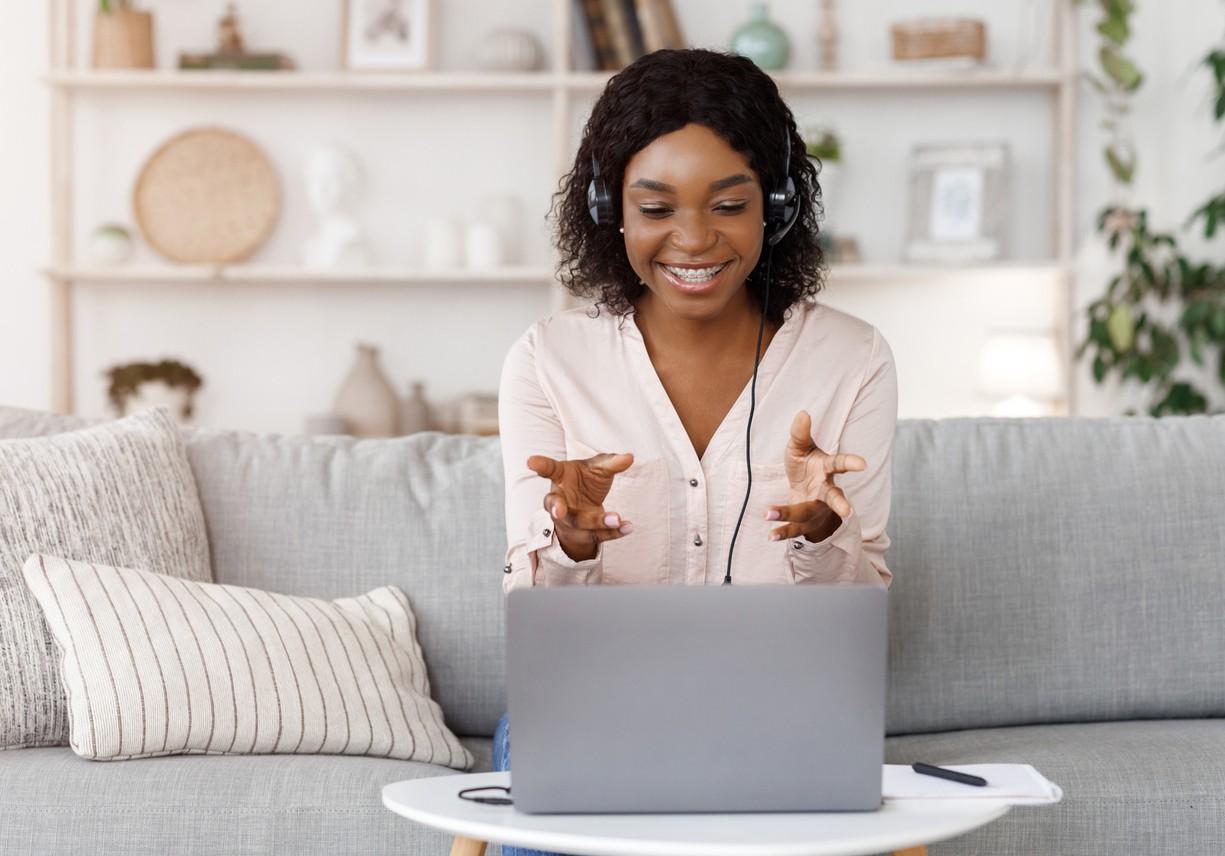 Woman coaching someone online