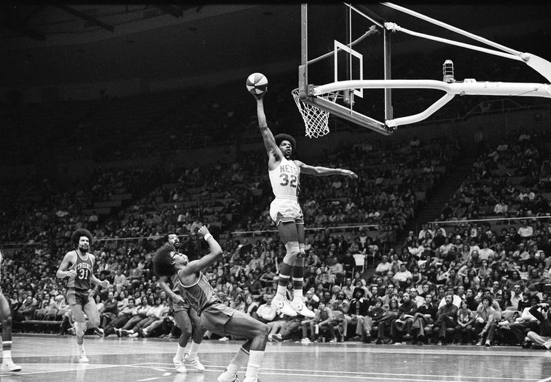 New York Nets' Julius Erving scores