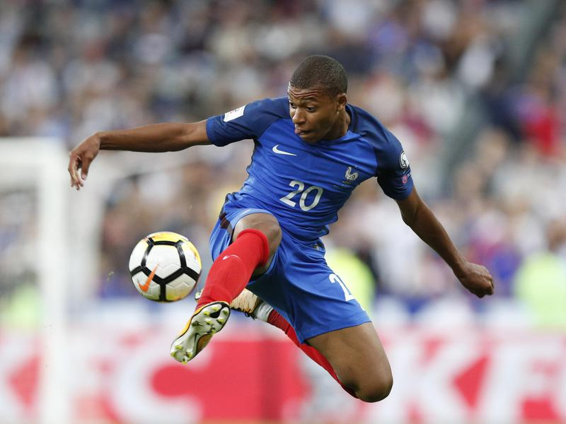 France's Kylian Mbappé controls the ball during a World Cup qualifying match between France and The Netherlands in 2017.