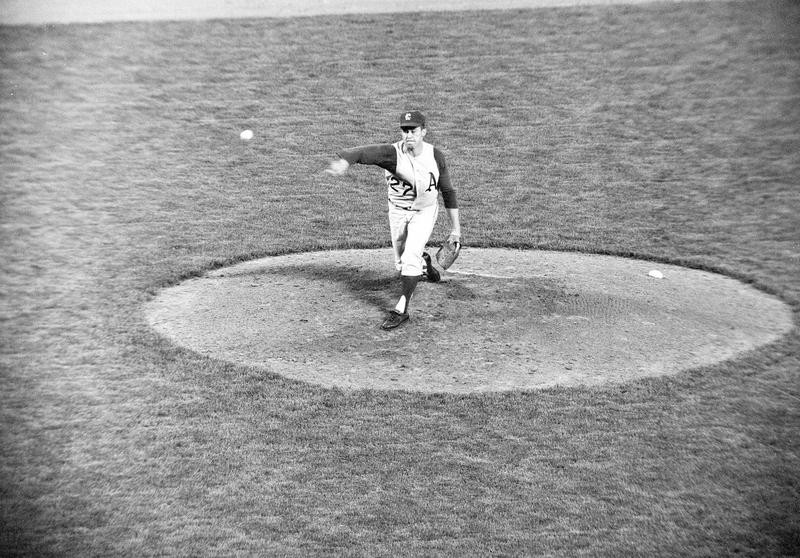 Jim Hunter throws pitch