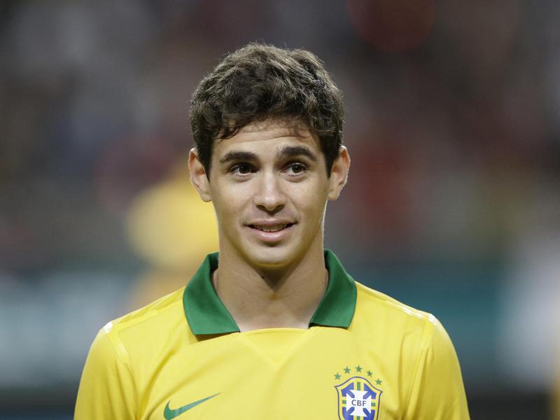 Brazil's Oscar lines up before a friendly against South Korea.