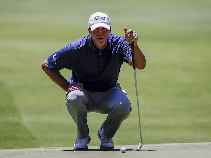 Steve Stricker lines up for his putt on fifth hole