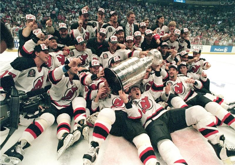 New Jersey Devils celebrate with the Stanley Cup in 1995