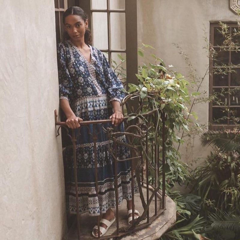 Woman in dress on balcony