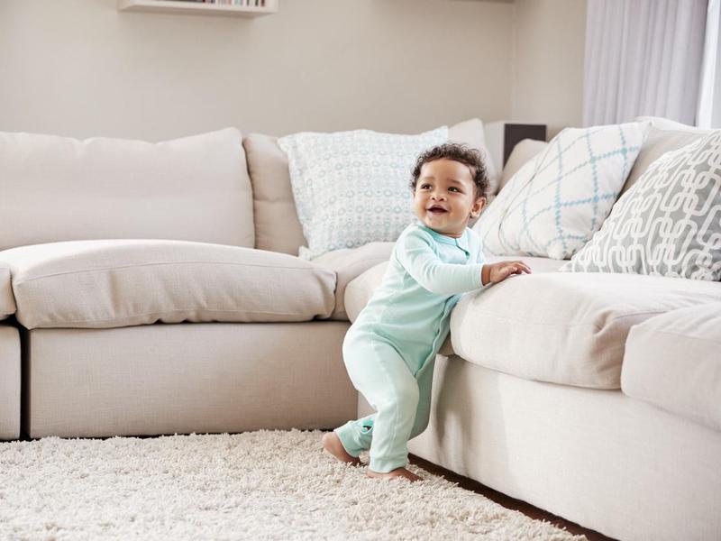 Toddler boy playing in sitting room