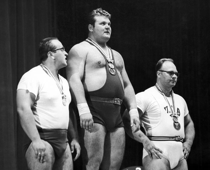 Yury Vlasov with others on podium