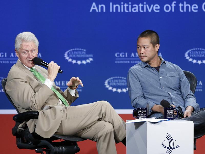 Former President Bill Clinton speaks with Zappos CEO Tony Hsieh (right) at the Clinton Global Initiative America in 2014.