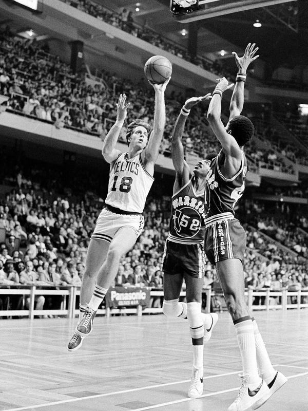 Dave Cowens of the Boston Celtics goes up for a basket