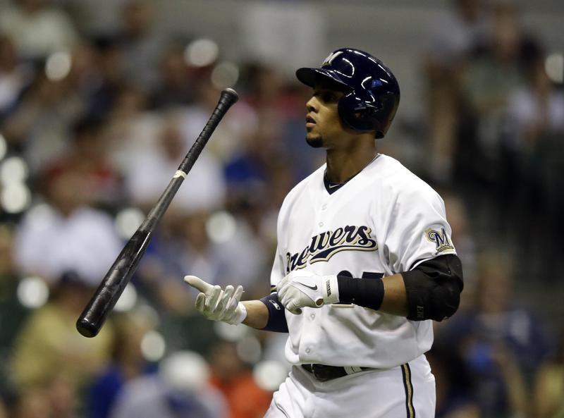 Carlos Gomez flips his bat