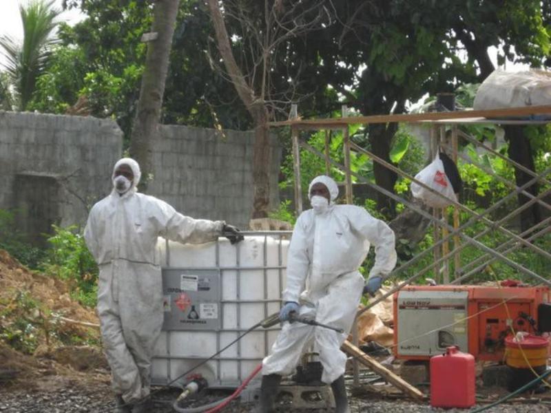 Men in hazmat suits in Dominican Republic