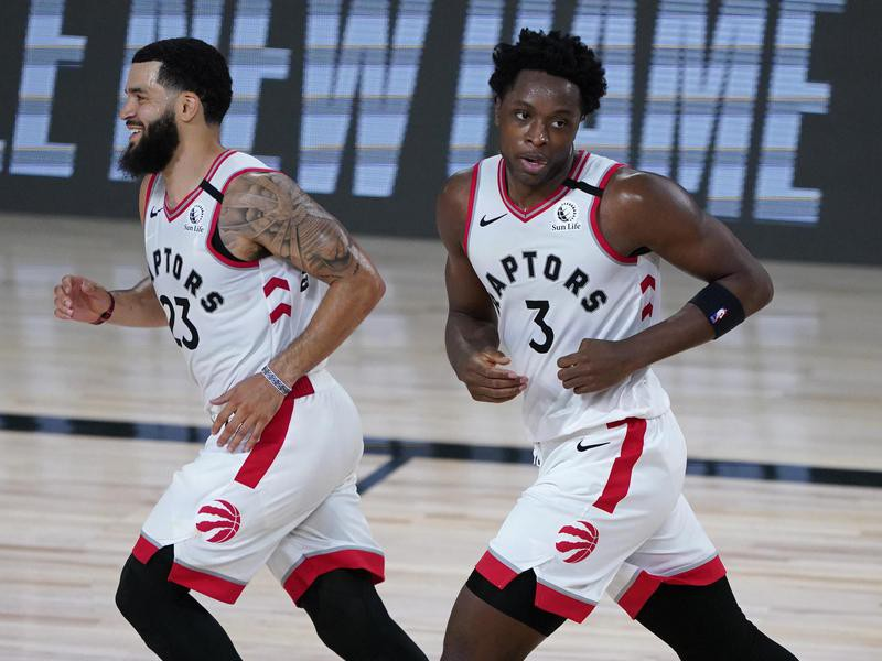 Toronto Raptors' Fred VanVleet and OG Anunoby react