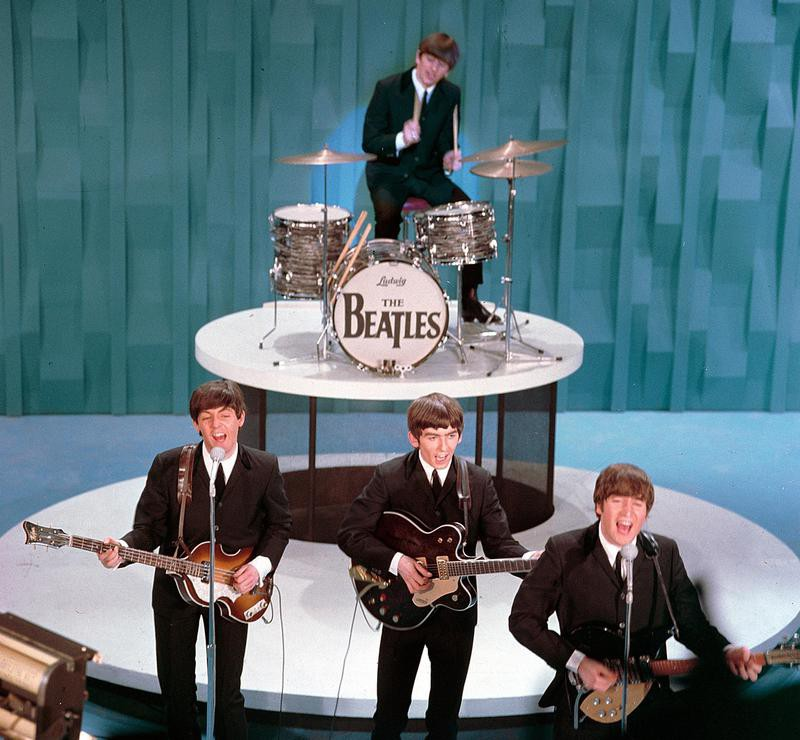 Ringo Starr performing with The Beatles on 'The Ed Sullivan Show in 1964