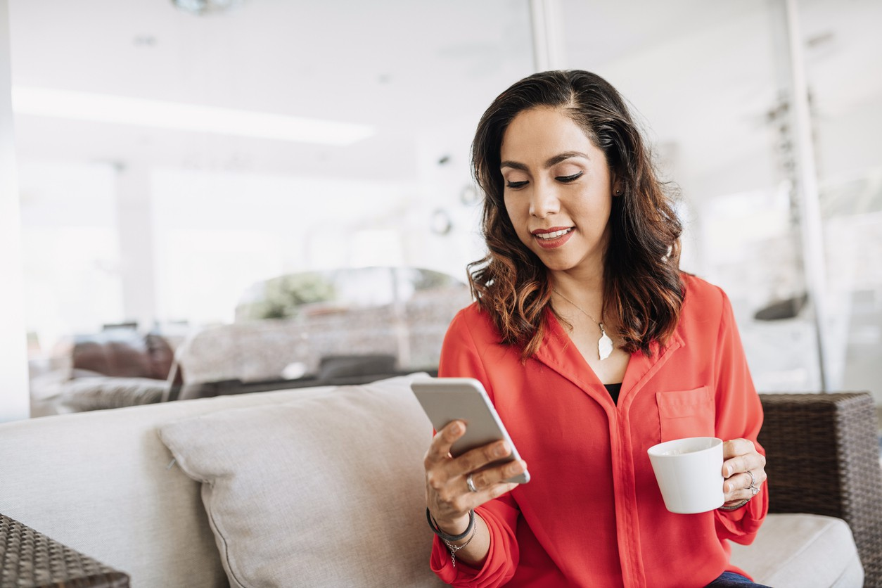 Woman working from home on her phone