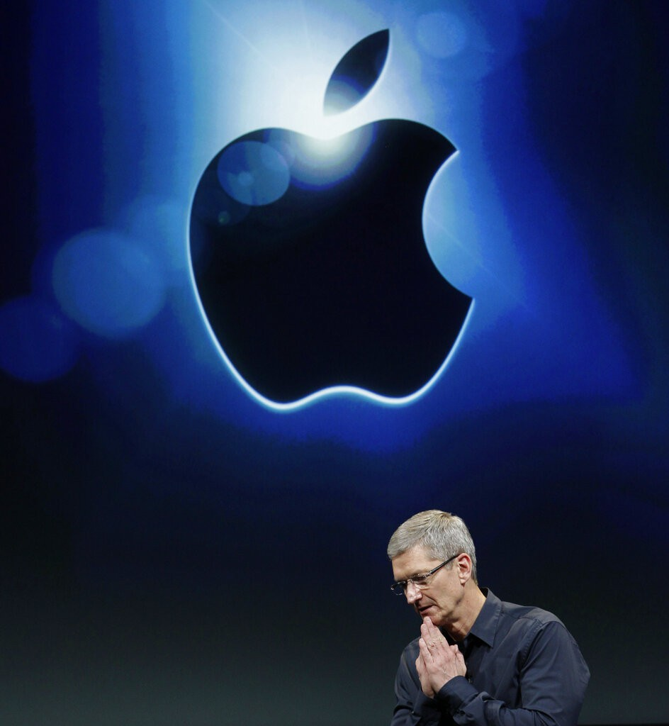 Tim Cook, CEO of Apple and Apple logo