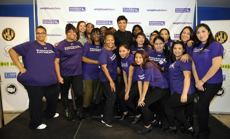 """Jennifer Hudson (top center) poses with B'more Fit members at a Baltimore Weight Watchers Event in 2014. Hudson launched her career on """"American Idol."""""""