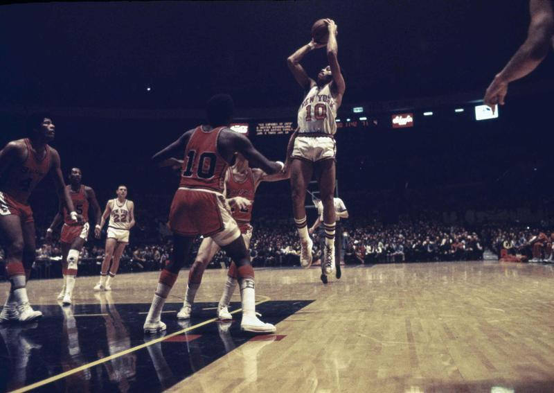 New York Knicks guard Walt Frazier pulls up for a jump shot