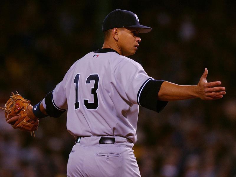 New York Yankees third baseman Alex Rodriguez looks toward his dugout