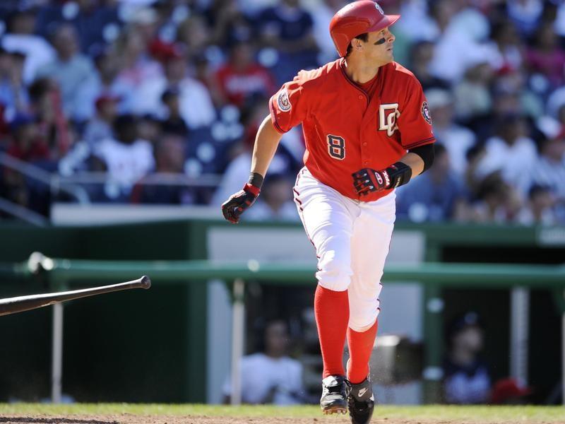Aaron Boone watches his three- run home run against Atlanta Braves