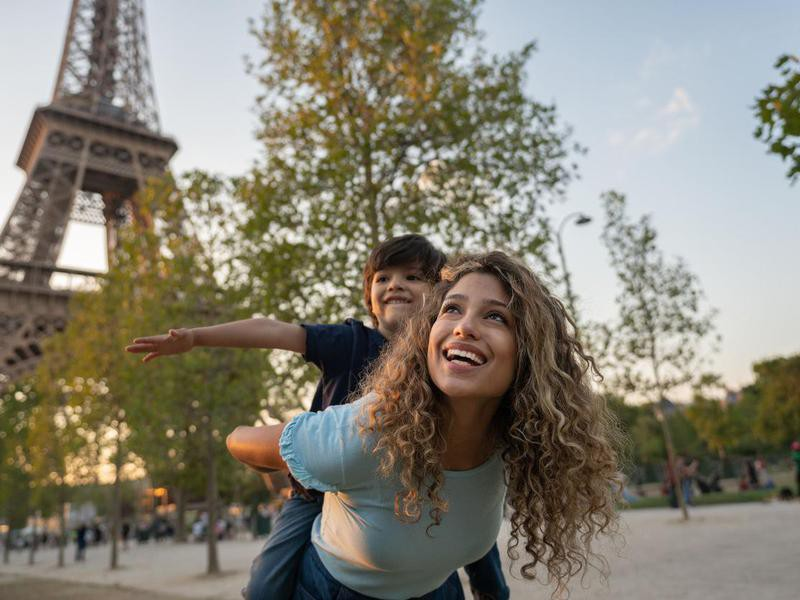 Happy mother and son traveling to Paris