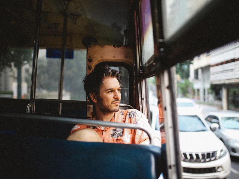 Young man riding on a bus