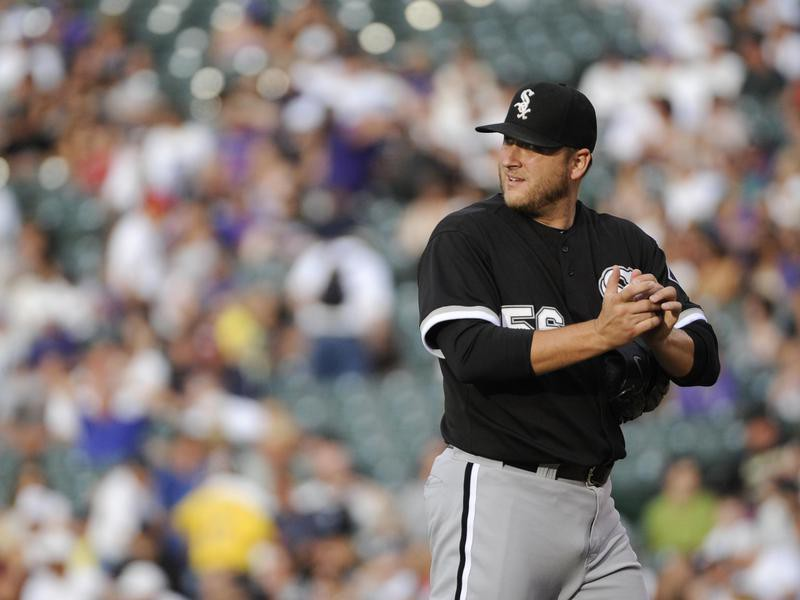 Chicago White Sox starting pitcher Mark Buehrle looks on against Colorado Rockies