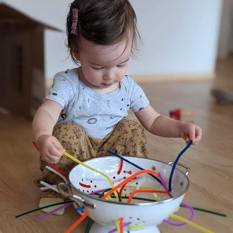 Girl playing with colander