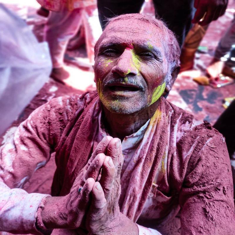 Man praying during Holi