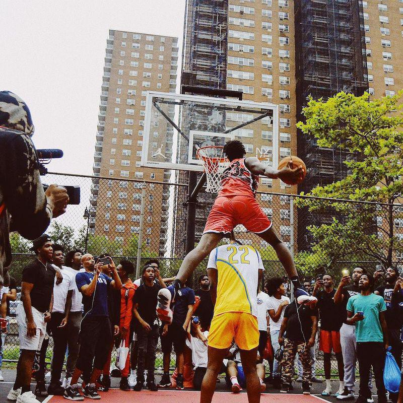 People playing basketball at Rucker Park