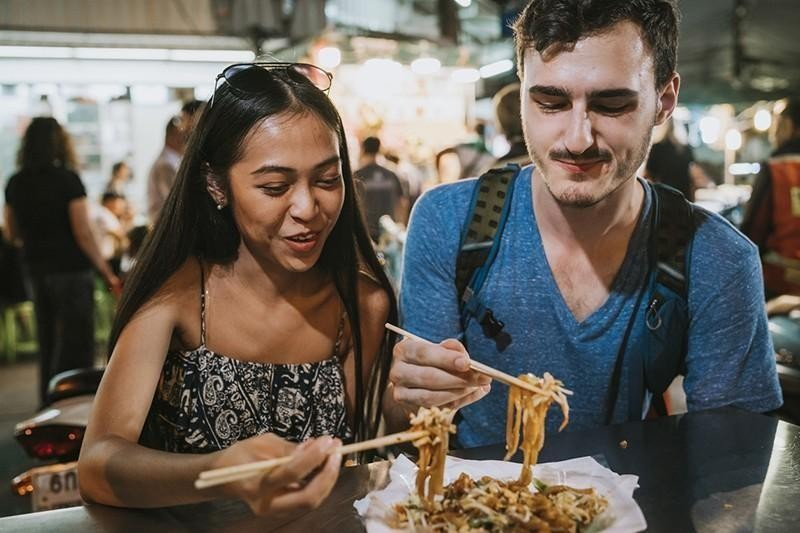 couple eating with chopsticks