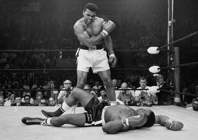Muhammad Ali reacts after he defeats Sonny Liston