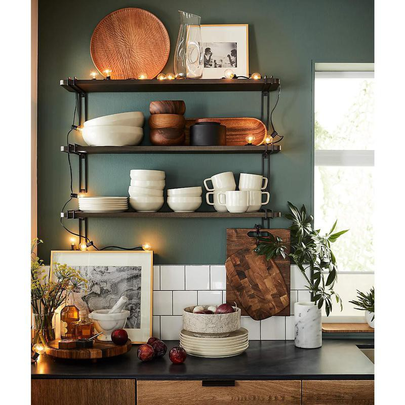 Open shelving in a kitchen with Christmas lights