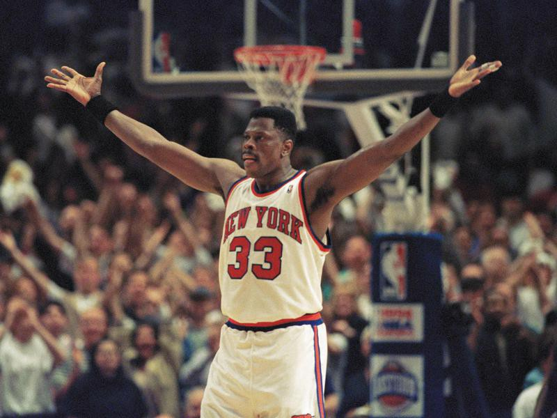 New York Knicks center Patrick Ewing pumps up fans crowded into New York's Madison Square Garden