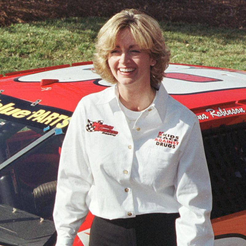 Shawna Robinson stands by ARCA series race car