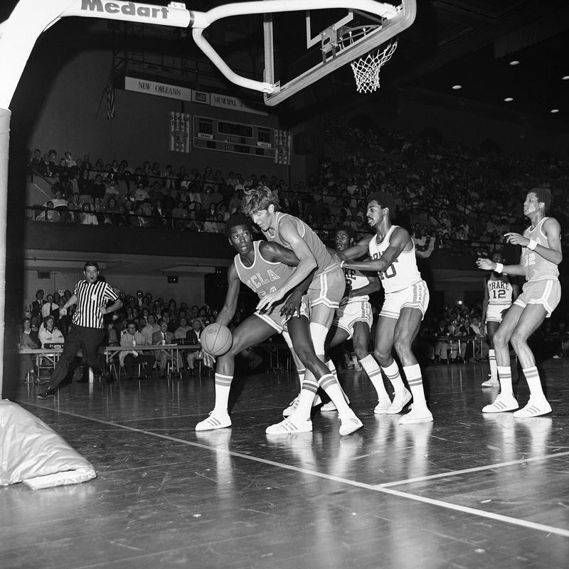 Bill Walton of UCLA dribbling