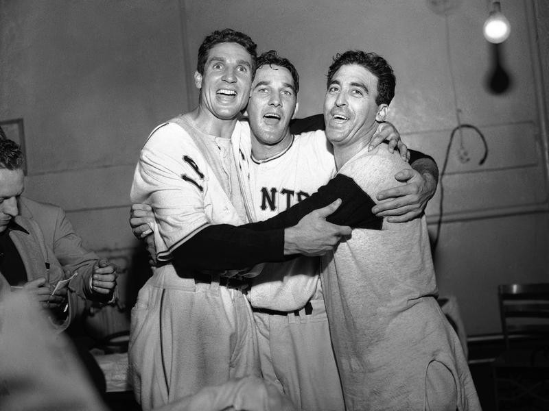 Sal Maglie with teammates celebrate their win over Brooklyn Dodgers