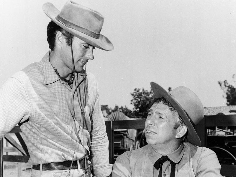 """Clint Eastwood, with Slim Pickens, acts on the set of """"Rawhide"""" in 1965."""