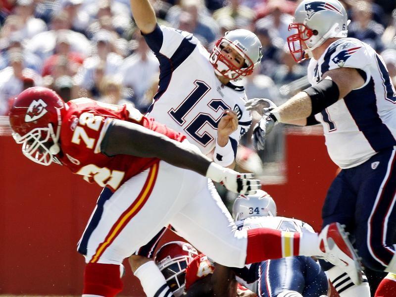 Tom Brady is hit by Bernard Pollard