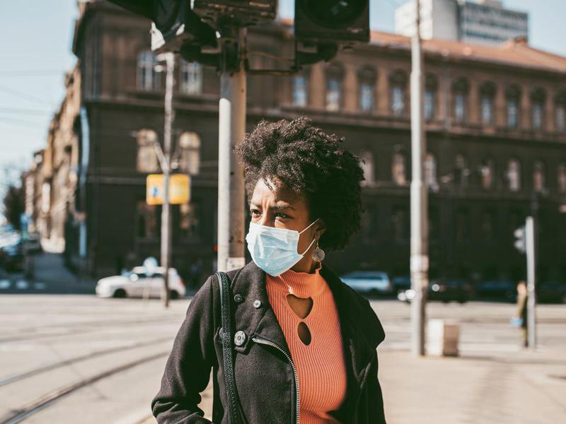 woman outside wearing mask