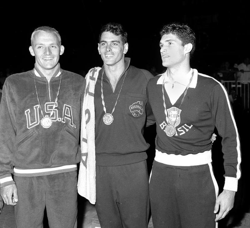 John Devitt, center, at medal ceremony
