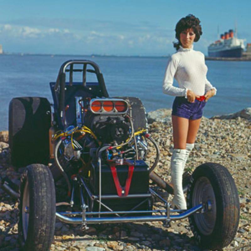 "Shirley ""Cha Cha"" Muldowney poses on vehicle"