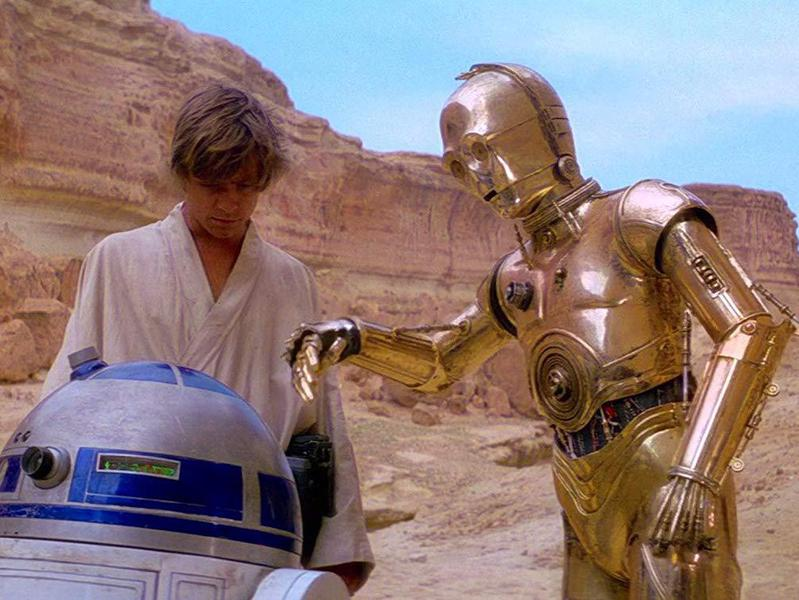 Anthony Daniels, Mark Hamill, and Kenny Baker in Star Wars (1977)