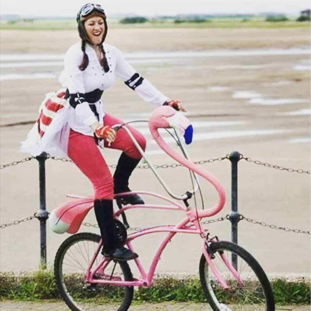 Woman on flamingo bike