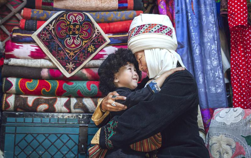 Kyrgyz mother and her son in their home yurt