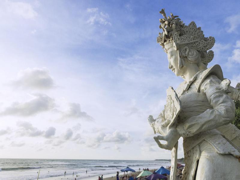 Balinese Sculpture overlooking beach in Bali