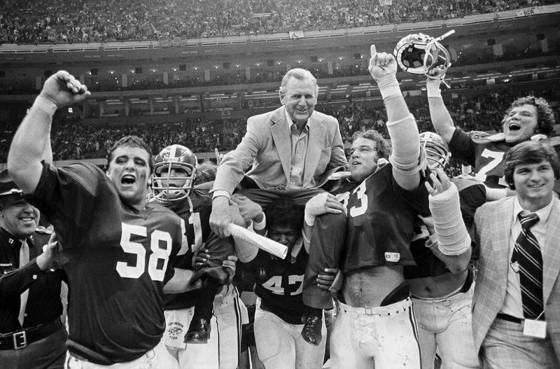 "Alabama coach Paul ""Bear"" Bryant carried off field"