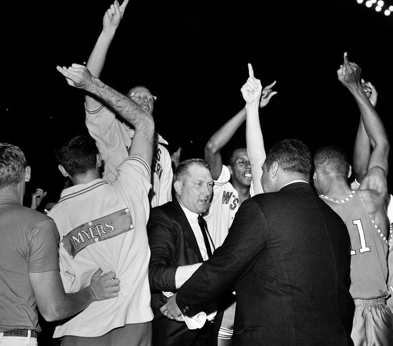 Coach and team of Texas Western Miners celebrate win