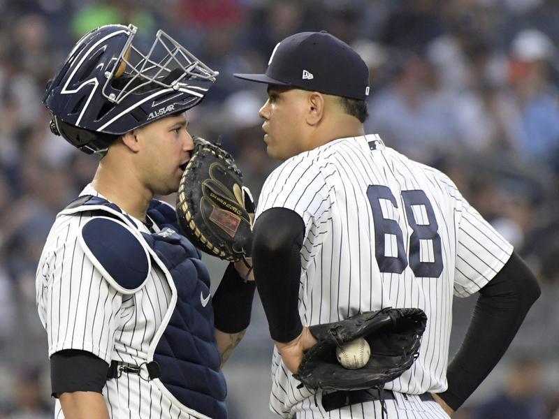 New York Yankees catcher Gary Sanchez confers with pitcher Dellin Betances