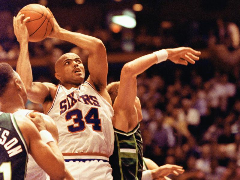 Philadelphia 76ers forward Charles Barkley crashes through the defense of Milwaukee Bucks